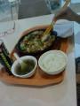 Типичныое блюдо - всё готовиться прямо на плите возле кассы